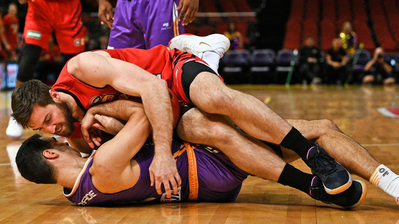 Nick Kay of the Wildcats and Kevin Lisch of the Kings fall on the court during Game 3 of the NBL Finals match at Qudos Bank Arena