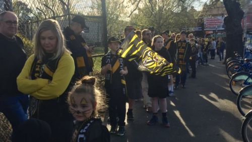 Tiger Army lines up more than 2km to get into the training session.