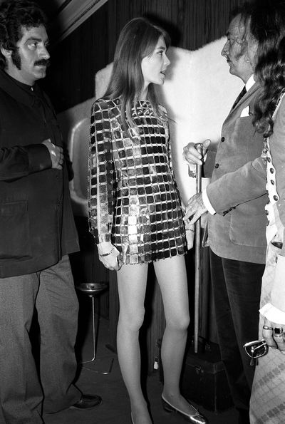 Francoise Hardy wearing a mirrored Paco Rabanne dress and partying with Salvador Dali in 1968.