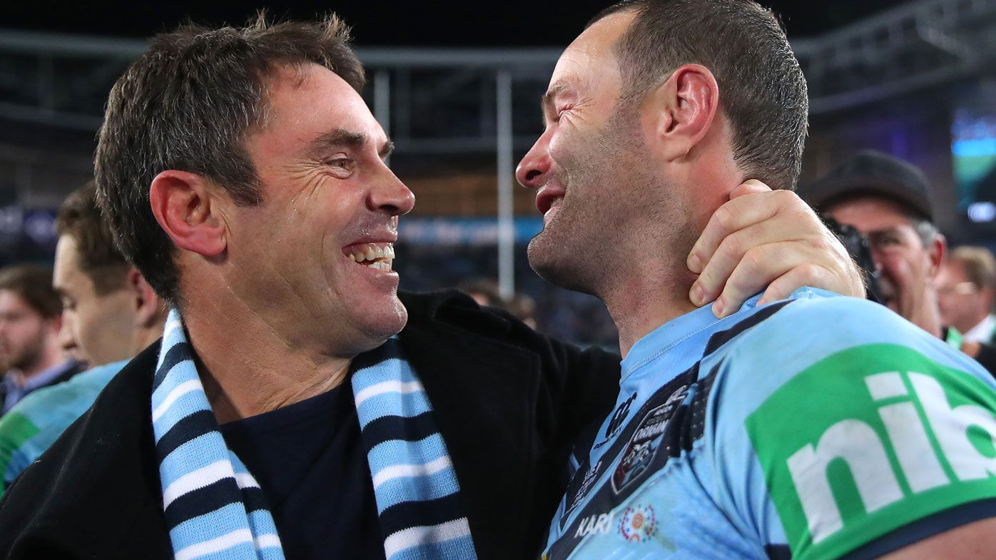 Brad Fittler and Boyd Cordner share an embrace. (Getty)