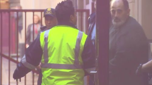 Cardamone arrives at the Supreme Court of Victoria. (9NEWS)