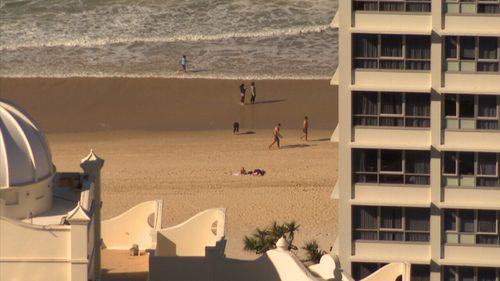 Drones have been seen snooping on beachgoers on the Gold Coast.