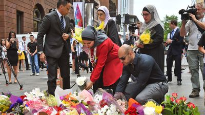 Representatives of Australia's Muslim community show their respects. (Getty)
