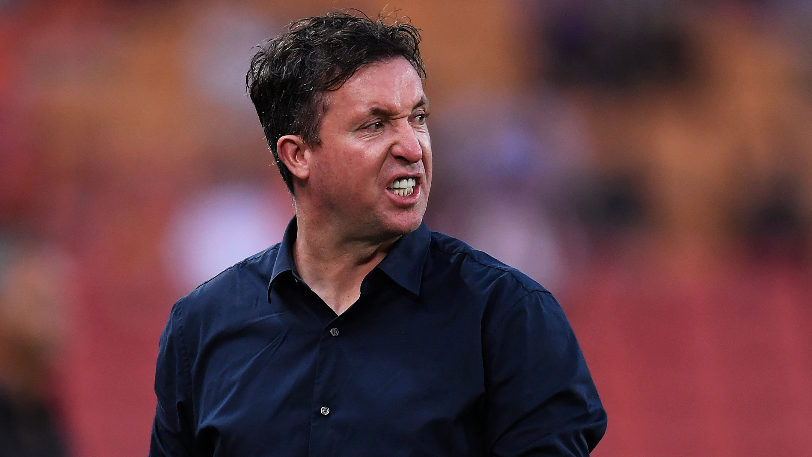 Roar coach Robbie Fowler peeved by United coach Mark Rudan