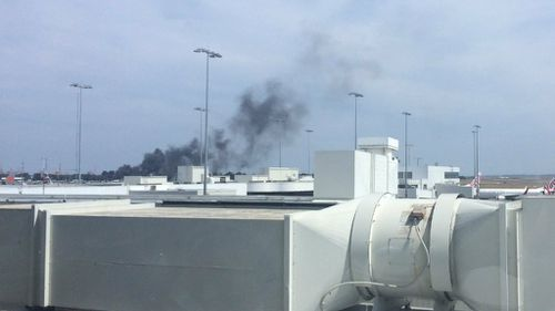 Smoke from the fires was visible from the airport terminals. (Twitter/@miss_nay_)