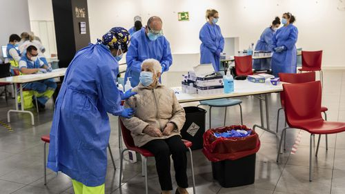 Madrid Emergency Service (SUMMA) health workers conduct rapid antigen tests for COVID-19 in the southern neighbourhood of Vallecas in Madrid, Spain, Friday, October 2, 2020