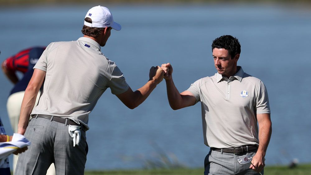 Thomas Pieters and Rory McIlroy.(AAP)