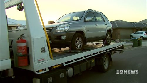 Willis' silver Kia SUV was taken by detectives from outside the Werribee home on Friday. Picture: 9NEWS