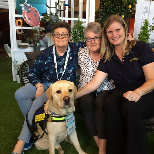 L to R: Edie (who has dementia), carer Anne, assistance dog Melvin, trainer Greer Gerson of Seeing Eye Dogs Australia. (9NEWS)