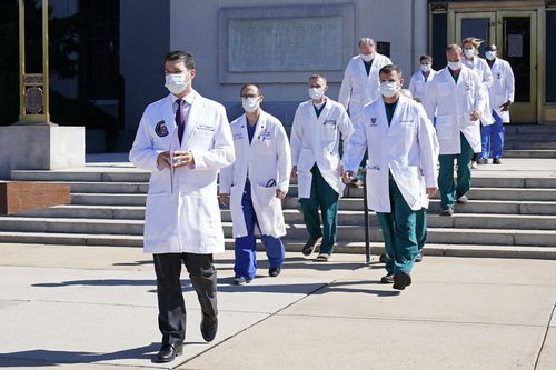 Dr Sean Conley, physician to President Donald Trump, is followed by a team of doctors for a briefing with reporters at Walter Reed National Military Medical Centre. (AP Photo/Susan Walsh)