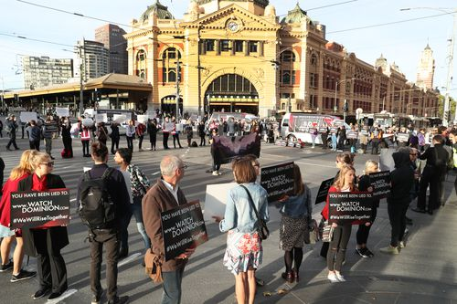 Animal rights protesters are blocking a CBD intersection.