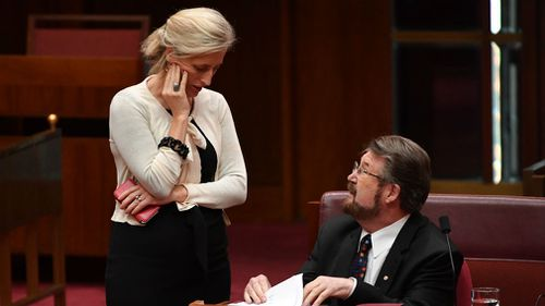 Labor Senator Katy Gallagher and Justice Party Senator Derryn Hinch during a debate on the Company Tax Bill. (AAP)