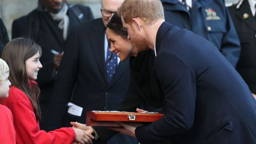 The royal couple greeted their namesake students. (Getty)