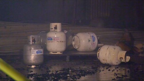 Smouldering debris has sparked fresh gas explosions at a factory in Melbourne's east.
