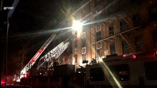 Firefighters at the scene of the blaze. (FDNY)