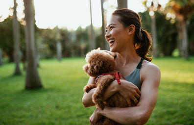 Woman outside with dog, laughing stock image