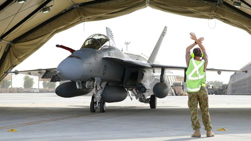 An Australian fighter jet lands in the Middle East. (AAP)