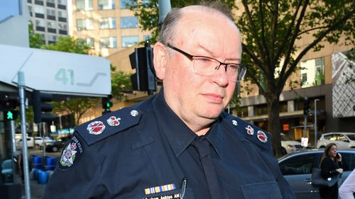 Victoria Police Chief Commissioner Graham Ashton arrives to the royal commission today.
