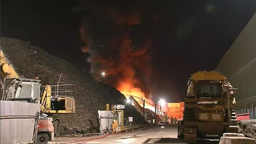 The fire tore through the factory, burning plastics and styrofoam, and releasing potentially toxic smoke into the air. Picture: 9NEWS.
