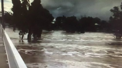 The swollen Todd River in Alice Springs, where a man went missing in floodwaters. (9NEWS)