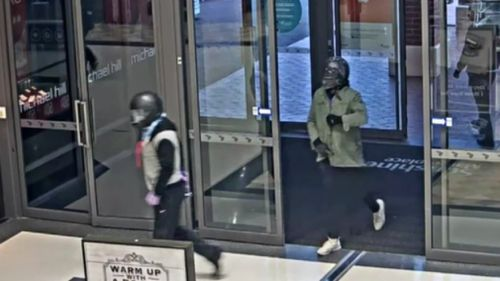 The armed offenders covered their face with motorcycle helmets during the robbery. (9NEWS)