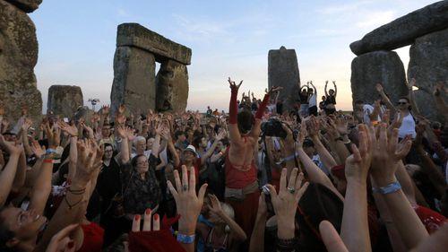 Revellers celebrate the summer solstice at Stonehenge near Salisbury. (AAP)