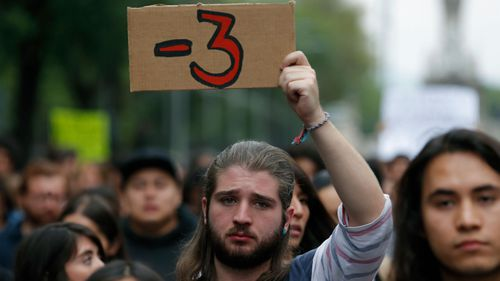 A man protests following the disappearance of three film students from the Mexican city of Guadalajara.