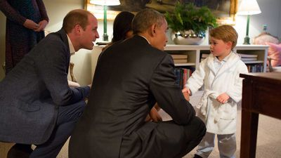 Barack Obama meeting the future king of England, Prince George.