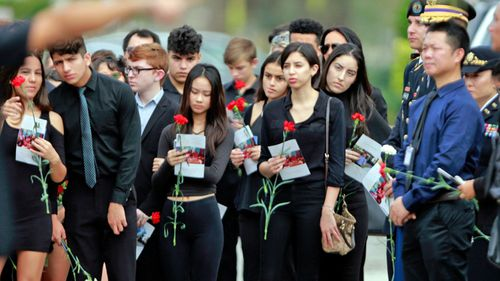 Mourners attend the funeral of Peter Wang/ (Photo: AP).