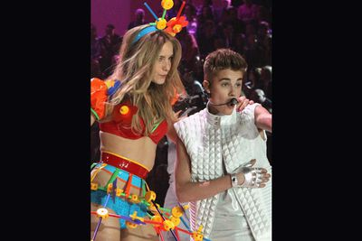 Justin Bieber performs 'Beauty and the beast' and causes chaos backstage, with Shanina Shaik labeling the then 18-year old as 'naughty' claiming the singer was chatting up the girls.  Rumours fly that the Biebs cheated on Selena Gomez with angel Barbara Palvin.