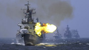A Chinese destroyer fires its guns during a drill.