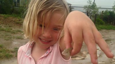 """<p>Heavy rain has flooded major roads around Winton, but residents of the drought-affected outback Queensland town have largely welcomed the much-needed downpour.</p><p>Adults and children have posed for happy snaps, and spectacular drone footage has revealed the extent of the rainfall. </p><p>Here, a girl holds a fish she found  on the drenched driveway of her family's cattle station, about 70km northwest of Winton. The family were<a href=""""http://www.9news.com.au/national/2016/03/11/15/44/its-raining-fish-outback-queensland-family-find-tiny-perch-in-puddles"""">shocked to find the tiny perch</a> in puddles on their property.</p><p><strong>Click through the gallery to see more images of the wet weather.</strong></p><p>(Facebook / Tahnee Oakhill)</p>"""