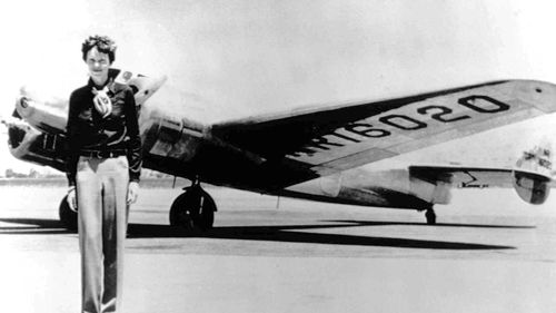 Amelia Earhart stands next to a Lockheed Electra 10E, not long before her last flight. (AP)