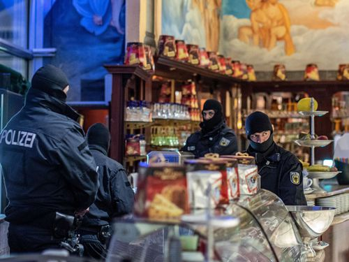 Police in four European countries carried out raids on the 'Ndrangheta's sprawling empire of money-laundering and drug-trafficking.