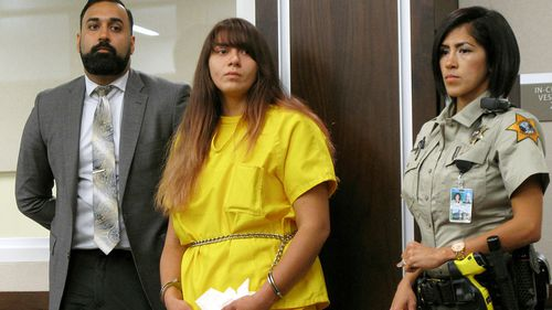 Obdulia Sanchez appears in a Los Banos, Calif., branch of the Merced County Superior Court with her public defender, Ramnik Samrao, left. Sanchez has been sentenced to six year and four months in prison for driving drunk while livestreaming the crash that killed her younger sister. The Merced Sun Star reports 19-year-old Obdulia Sanchez was sentenced Thursday, Feb. 8, 2018 after being convicted of gross vehicular manslaughter, DUI and child endangerment stemming from the July 2017 crash. (AP Photo/Scott Smith, File)