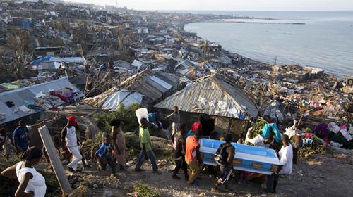 A group carry a coffin amid devastation in Haiti. (AP)