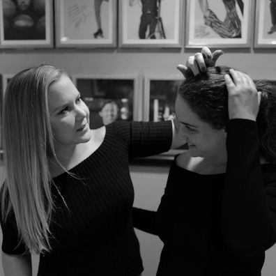 Amy Schumer poses with her sister Kim Caramele.