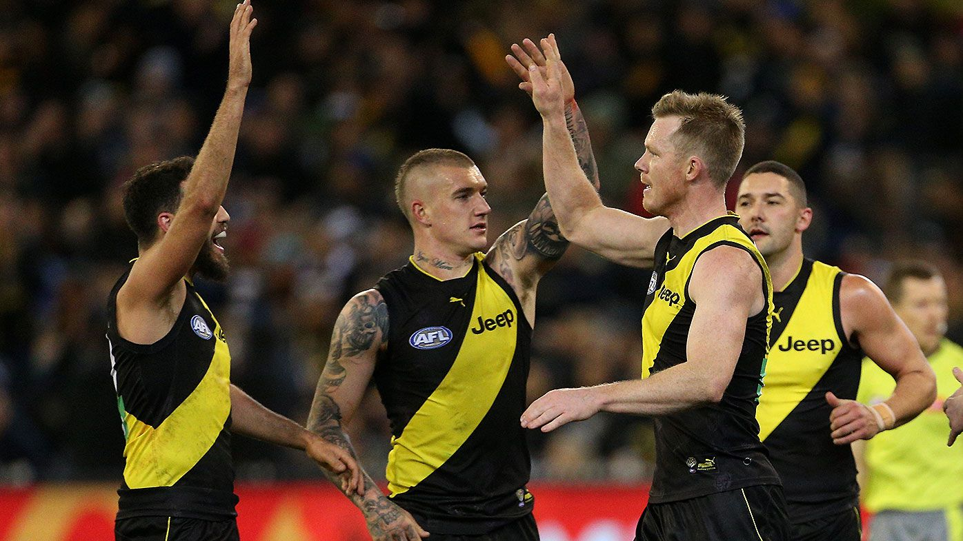 Richmond holds off late Geelong charge to win 19 straight at MCG