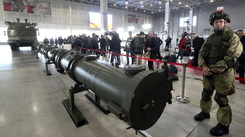 Russian military serviceman stands near the Iskander M Missile complex during a briefing on the issue of creation ground-based cruise missile 9M729 at Patriot military exhibition center in Moscow region, Russia.