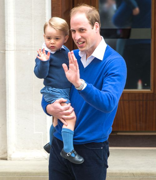 The two princes stop to wave at the crowd. (Getty Images)