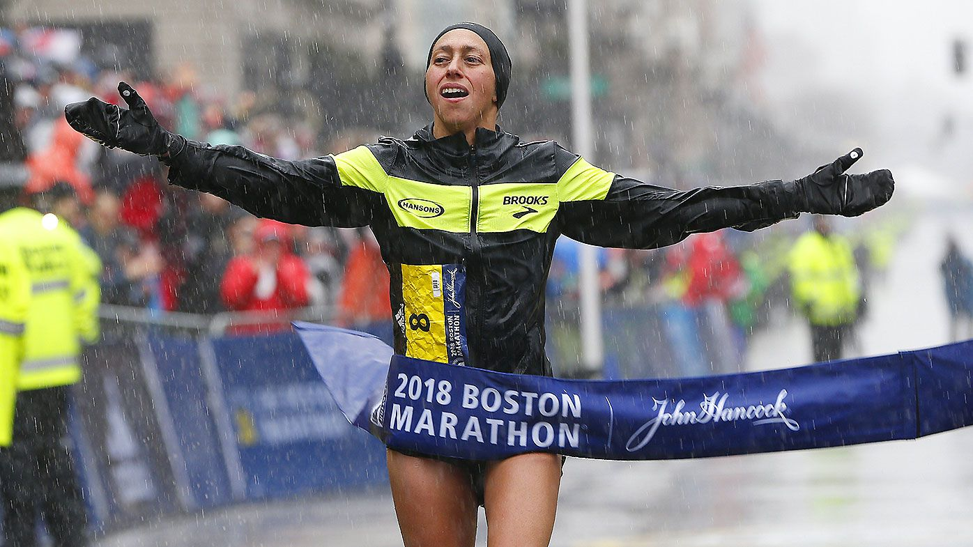 Desiree Linden of the US crosses the finish line to win the women's division of the 122nd Boston Marathon