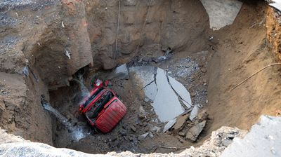 A truck was claimed in Beijing, China when a giant sinkhole opened up in April 2011. (Getty)