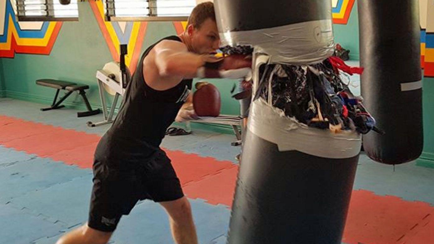Jeff Horn split a heavy bag in training