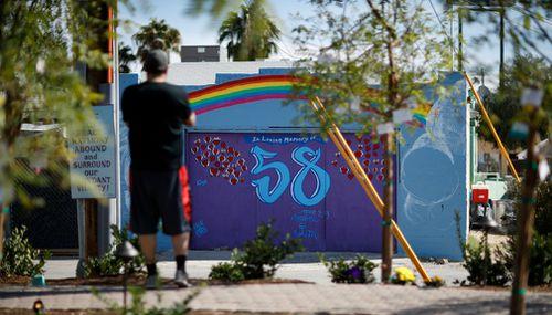 A mural honoring 58 victims adorns a building at the Las Vegas Community Healing Garden. (AP)