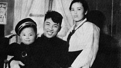 <p><b>Kim Jong Il: Of Blessed Birth</b></p>Kim Jong Il pictured as a child with his parents. According to his official biographers, his birth in 1941 in Baekdu Mountain was apparently prophesied by a swallow and heralded with a double rainbow and a new star in the heavens. (Supplied)