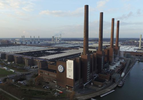 The Volkswagen factory, including its heating plant with its four chimneys, stands in Wolfsburg, Germany.