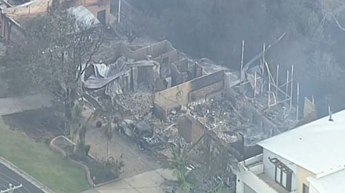 Strong winds are expected to create more dramas for fire crews working to contain the Tathra fire. (9NEWS)