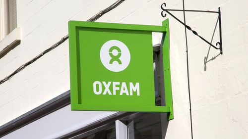 An Oxfam charity shop sign in Wiltshire, England. (Getty)