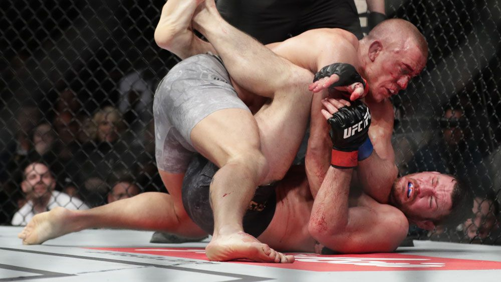 Georges St-Pierre scores stunning comeback win over Michael Bisping at UFC 217