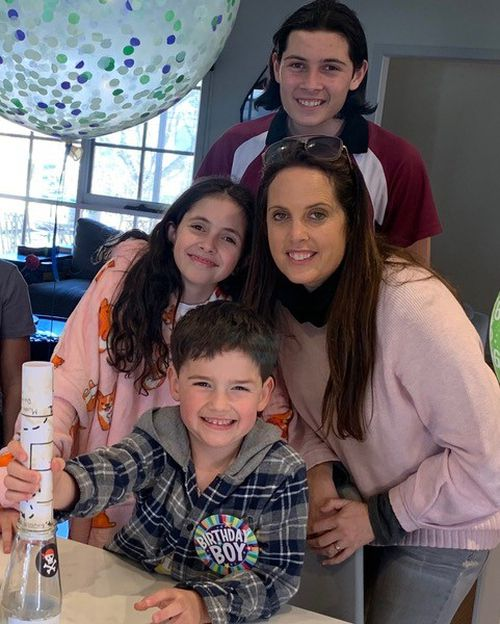 Julie Rosenbloom with her three kids, Kade (front), Anika (left) and Brody (back).